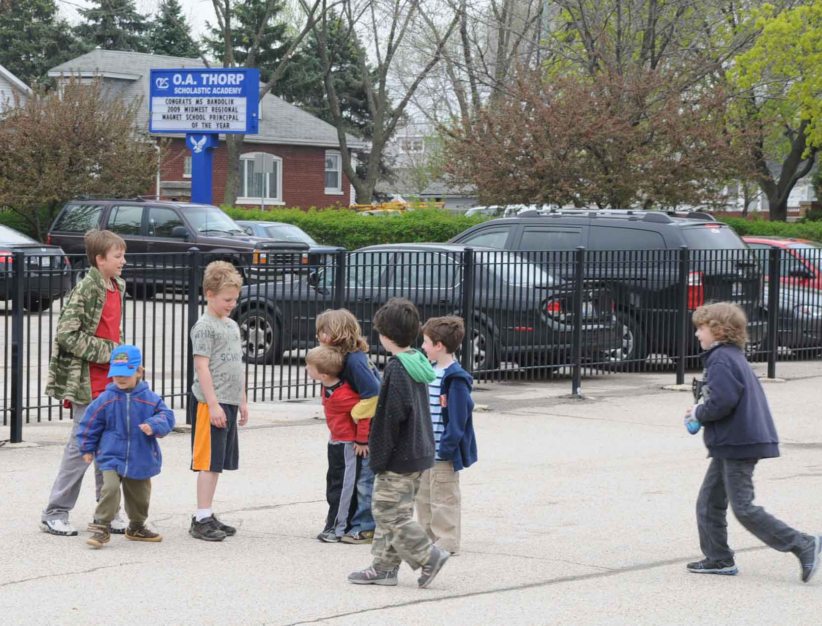 Boys from O.A. Thorp playing after school in April 2009. Substance photo by George N. Schmidt.