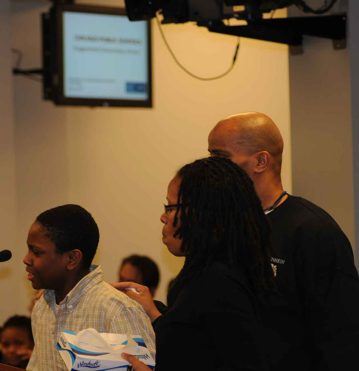 When one of the students who testified against the closing of Guggenheim Elmentary School broke down in tears during the January 29, 2010 hearing, teachers Jacqueline Jones and Earnest Jones brought tissues and comfort to him. Substance photo by George N. Schmidt.