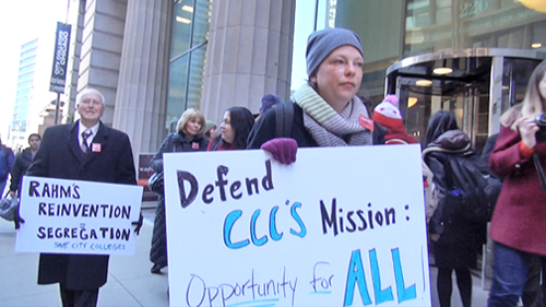 Jennifer Alexander, foreground, leads a delegation with the Chicago City Colleges statement of no confidence in Chancellor Cheryl Hyman over to Mayor Rahm Emanuel. Photo: Labor Beat