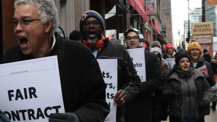 Cook County Board President and mayoral candidate Toni Preckwinkle, left, joins dozens of charter school teachers and other CTU memebers as they rally along the 200 block of West Jackson Boulevard in Chicago on Dec. 4, 2018. (Antonio Perez/Chicago Tribune)