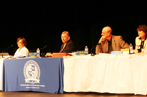 The Board of Education members were arrayed on stage at Brooks High School on June 24, 2015. Above, left to right: Mahalia Hines, David Vitale, Carlos Azcoitia, and Gail Ward. Substance photo by David Vance.
