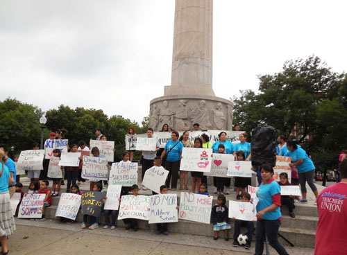 Children and teenagers from all of the schools in the Logan Square community gathered at the monument at the center of the community with signs showing how much Rahm Emanuel's Board of Education has robbed from their schools this year. The crowd assembled at