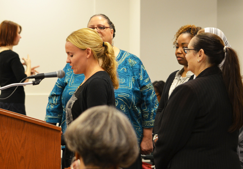 Accompanied by Chicago Teachers Union President Karen Lewis (half obscured behind the speaker) and CTU Quest Center and NBCT coordinator Lynn Cherkasky-Davis (above right),one of the more than 100 new NBCT teachers told the the Chicago Board of Education about her work and the program. After praising the program, the Board then went into its meeting, where teachers were again disregarded and major Power Point presentations on educational issues were delivered by highly paid CPS executives who had never taught in Chicago schools and whose main qualifications for their current administrative offices are the fact that they hold MBA degrees and are willing to deliver carefully scripted Power Point presentations in support of usually destructive corporate school reform programs. Substance photo by George N. Schmidt.