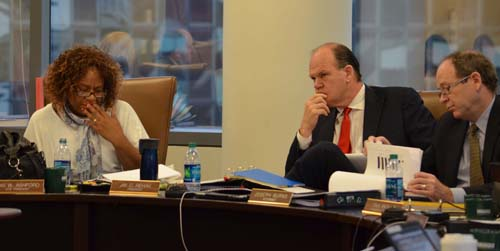 Chicago Teachers Pension Fund trustees Lois Ashford (left) and Jay Rehak (center) listen to one of the reports at the October 18, 2012 meeting of the trustees of CTPF. On the right is attorney Joseph Burns. Substance photo by George N. Schmidt.