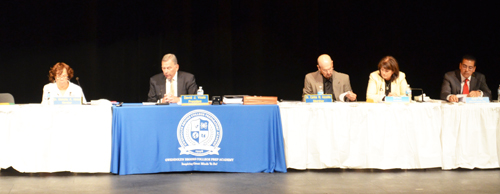 Members of the Chicago Board of Education continued their cynical disregard for the needs of the schools and their legal obligations during the June 24, 2015 Board meeting. Above, left to right, on stage at Brooks High School during the meeting, are Mahalia Hines, David Vitale, Carlos Azcoitia, Gail Ward, and Jesse Ruiz. Substance photo by George N. Schmidt.