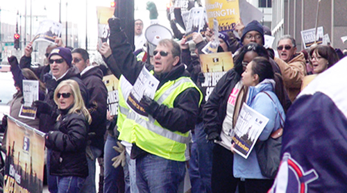 BP workers protesting in Chicago at the corporation's Chicago office. Labor Beat photo.