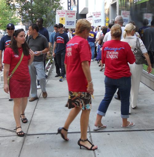 Chicago Teachers Union researcher Sarah Hainds (left) showing solidarity with striking security guards at 161 W. Kinzie building on September 1, 2011. Substance photo by George N. Schmidt.