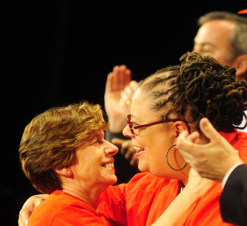 AFT President Randi Weingarten, who never was really a New York City public school teacher, hugging former Chicago chemistry teacher (and CTU President) Karen Lewis on stage at the May 23, 2012, CTU rally inside the Auditorium Theatre. Substance photo by Graham Hill.
