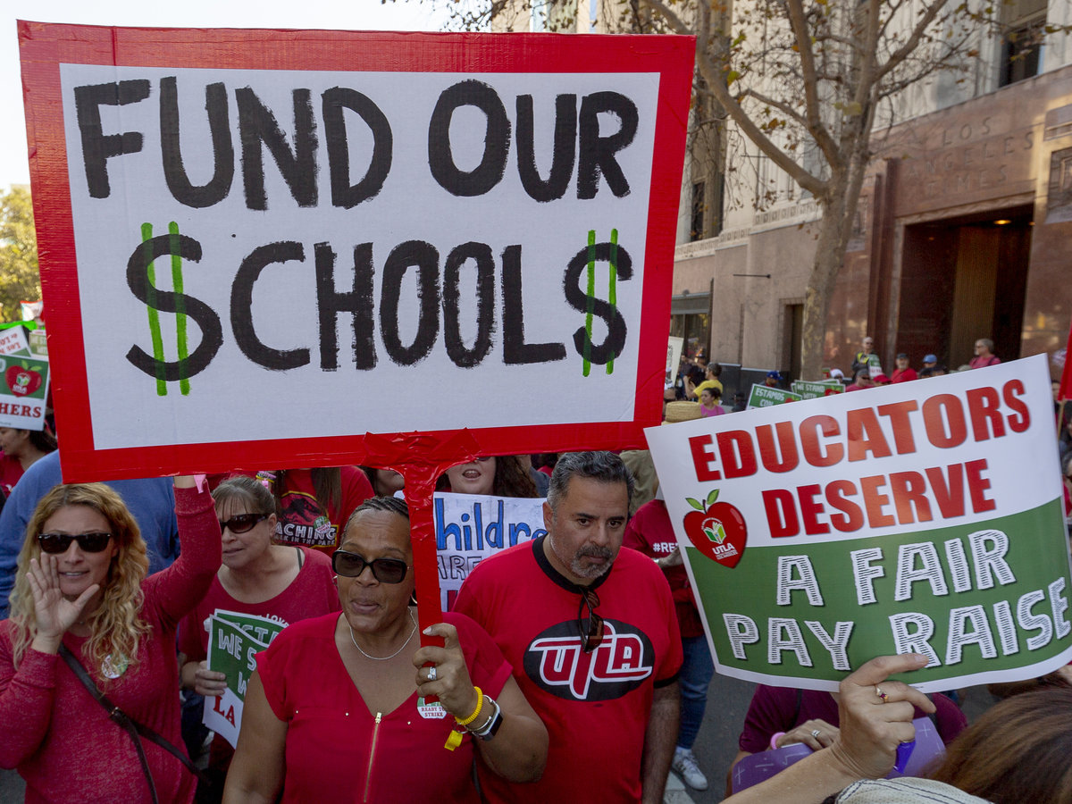 A picture prior to the strike shows homemade signs pushing for better pay. But the UTLA's signs during the strike said,
