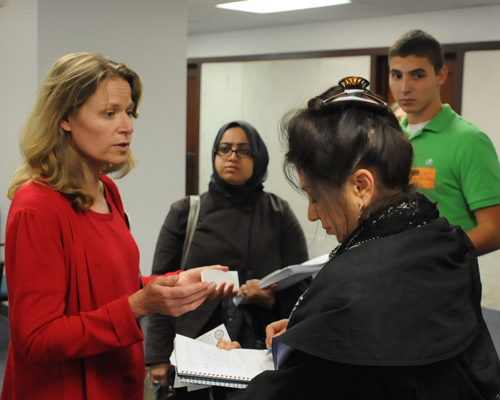 Sharon Schmidt tries to explain a major point about testing to Sun-Times reporter Rosalind Rossi while Rossi takes notes holding Sharon's Substance Editor business card. Substance photo by George N. Schmidt.