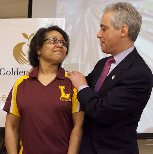 The mayor's publicity stunt photograph depicting Rahm being nice to a teacher. The photo was provided to the press by the Mayor's Press Office on May 1, 2013.