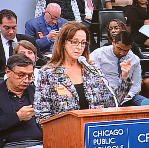 Dianne Daleiden speaks to the Board of Education's July 23, 2014 meeting about the attempt by American Quality Schools to expand the number of seats at the Passages Charter School which it operates against the community's wishes in the Andersonville Community on Chicago's North Side. Substance photo by George N. Schmidt.