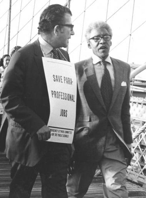 United Federation of Teachers President Albert Shanker (left) with civil rights leaders Bayard Rustin (right) crossing the Brooklyn Bridge during one of the UFT's actions for public education in New York.