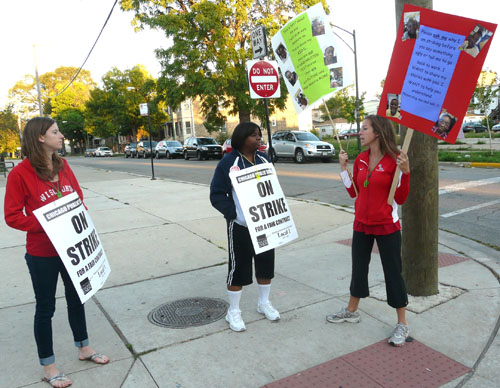 Striking teachers picket outside Hefferan Elementary School on Chicago's West Side before seven in the morning on September 12, 2012, some carrying CTU signs, others with their own clear messages. Substance photo by Kati Gilson.