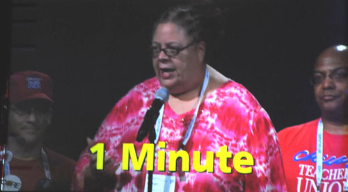Chicago Teachers Union President Karen Lewis was prominent on the floor of the AFT convention in Detroit. Above, Lewis spoke in favor of the AFT Solidarity Resolution, which had been introduced as a Special Order of Business, just before Joe Biden's speech. Biden's media handlers threatened to confiscate Substance's camera when this photograph was taken, as part of the silly attempts to manipulate press coverage of the convention by the representatives of the Obama-Biden campaign office out of Chicago. Substance photo by George N. Schmidt.
