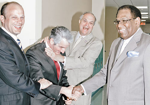 The man second from left in the above photograph, depicted as bowing before the mayor and school board chief of New Haven Connecticut, is David Cicarella, President of the New Haven Federation of Teachers, a local of the American Federation of Teachers. The above photograph, which had to have been approved by Cicarella, illustrated the May 9, 2013 article entitled