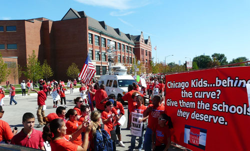 Strikers and supporters, including many students, begin to line up for the march through Chicago's West Side outside Marshall High School (background building) on September 13, 2012, the fourth day of the Chicago Teachers Strike of 2012. Substance photo by Kati Gilson.