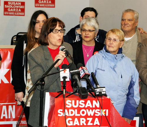 Surrounded by family and supporters, Jane Addams Elementary School counselor Sue Sadlowski Garza declared victory in the 10th Ward aldermanic race on April 8, 2015. Substance photo by David Vance.