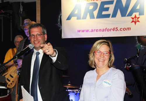 Chicago's 45th Ward Alderman John Arena (above left) celebrated his re-election on election night, April 7, 2015, with his wife Jill and supporters at the La Pena restaurant. Arena was targeted for numerous attacks by various PACs backing Rahm Emanuel because he had voted against Emanuel's policies more than any other member of the City Council during Emanuel's four years in office.
