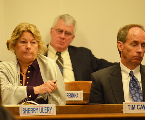 Above, Sherry Ulery, _____, and Tim Cawley at the October 23, 2013 meeting of the Chicago Board of Education. Ulery was given a