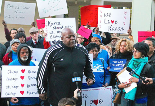 Jitu Brown (above speaking) was one of several speakers who gave their love and support to Karen Lewis during a rally at her old school, King HS, on October 9, 2014. Photo by Bob Simpson.