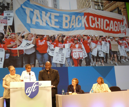 In addition to leading the Chicago Teachers Union since 2010, Karen Lewis has become a national leader in the fight for justice, equity, and public schools. Above, on July 12, 2014, Lewis joined with Asean Johnson (then a ten-year-old CPS student) at the podium at the national convention of the American Federation of Teachers. While Johnson spoke, Karen Lewis (left), Jitu Brown (third from left), Randi Weingarten (second from right) and Loretta Johnson (right) looked on. Substance photo by Kati Gilson.