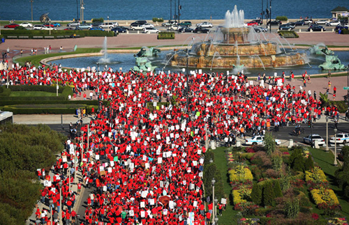 Sunny days helped the Chicago Teachers Strike of September 2012, which lasted for seven school days. Above, teachers stream around Buckingham Fountain for a strike rally after a march through Chicago's Loop during the strike.