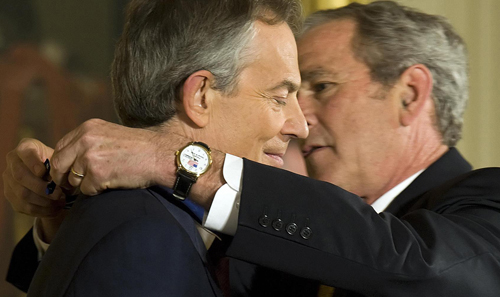 Tony Blair (left) and Geroge W. Bush were the two national leaders most responsible for the fraudulent 2003 invasion of Iraq. The subsequent endorsement of the Middle East wars by the Obama administration has come as no surprise to careful observers.