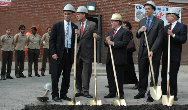 """October 15, 2007. Chicago Mayor Richard M. Daley (center, in gold hard hat) joins (left to right) Congressman Rahm Emmanuel, Chicago Alderman Ed Balzer, CEO Arne Duncan, and retired Marine General Michael Mulqueen. Behind Daley (right) on the wall of the former elementary school is the banner of the Chicago Public Schools """"Military Area Office"""" (which CPS claimed does not exist). To the left at ease are 9th grade students from the newly commissioned Marine Military Academy.  At the groundbreaking, Daley and Duncan announced an $8 million expansion of the """"Grant Campus"""" (which now houses the Marine Academy and the Phoenix Military Academy, an Army program). The money for the expansion of the military campus at Adams and Western on Chicago's West Side comes at a time when Daley and Duncan are telling public schools across Chicago that there is no money for capital improvements in the schools because the State of Illinois has refused to increase Chicago's percentage of state education funding. Substance photo by George N. Schmidt."""