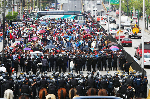 Like his counterpart to the north, the President of Mexico knows that the real threat to his nation is not greedy CEOs, corrupt corporations, or drug gangs -- so he sends his army and police, including mounted cops on horses, to attack protesting teachers. Photo by Al Jazeera.